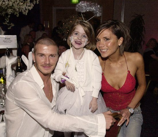 NGLAND CAPTAIN DAVID BECKHAM AND HIS POP STAR WIFE VICTORIA WITH 6 YEAR OLD KIRSTY.